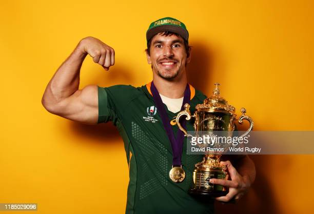 Eben Etzebeth of South Africa poses for a portrait with the Web Ellis Cup following his team's victory against England in the Rugby World Cup 2019...