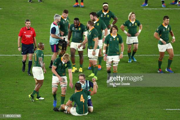 Eben Etzebeth of South Africa receives medical treatment during the Rugby World Cup 2019 Final between England and South Africa at International...