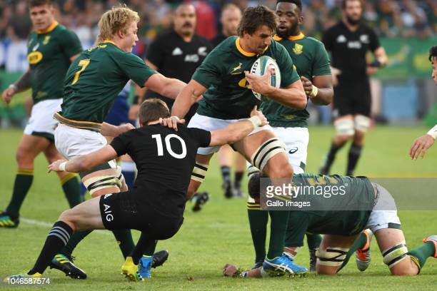 Eben Etzebeth of the Springboks tackled by Beauden Barrett of New Zealand during the Rugby Championship match between South Africa and New Zealand at...