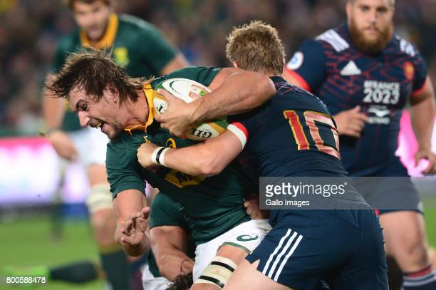 Eben Etzebeth of the Springboks tackled by Jules Plisson of France during the 3rd Castle Lager Incoming Series Test match between South Africa and...