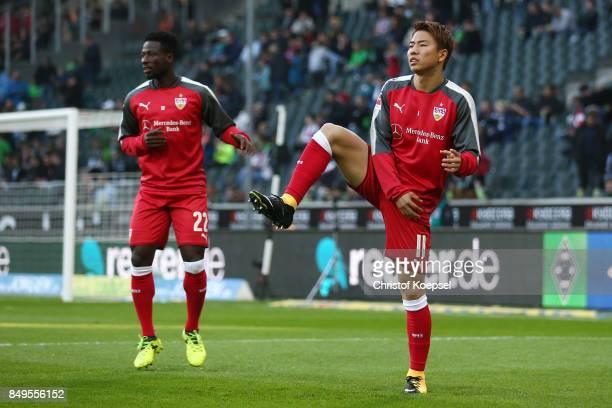 Ebenezer Ofori and Takuma Asano of Stuttgart during warm up before the Bundesliga match between Borussia Moenchengladbach and VfB Stuttgart at...