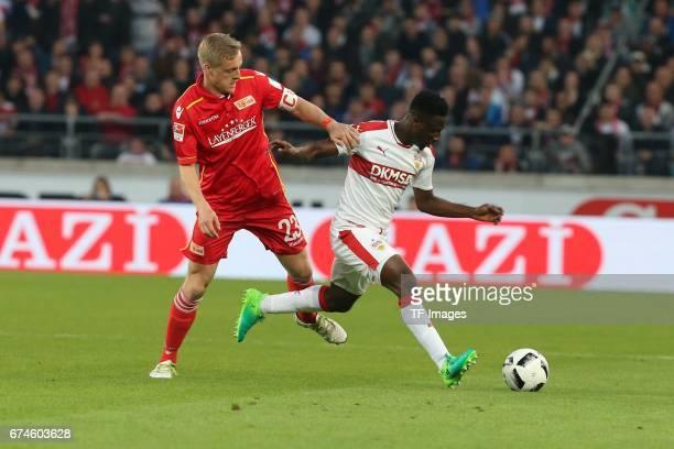 Ebenezer Ofori of Stuttgart Felix Kroos of Union Berlin battle for the ball during the Second Bundesliga match between VfB Stuttgart and 1 FC Union...