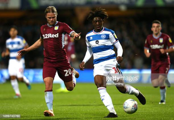 Eberchi Eze of QPR is closed down by Birkir Bjarnason of Aston Villa during the Sky Bet Championship match between Queens Park Rangers and Aston...