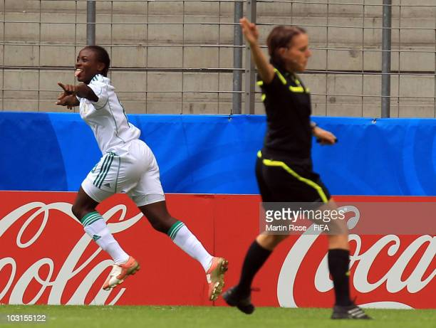 Ebere Orji of Nigeria celebrates after scoring the opening goal during the 2010 FIFA Women's World Cup Semi Final match between Columbia and Nigeria...