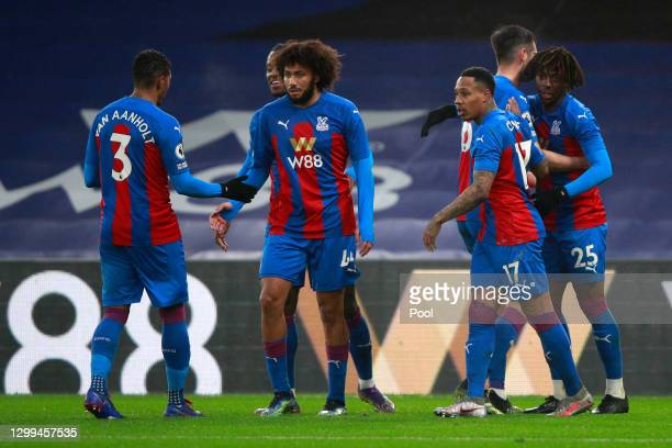 Eberechi Eze of Crystal Palace celebrates with teammates after scoring his team's first goal during the Premier League match between Crystal Palace...