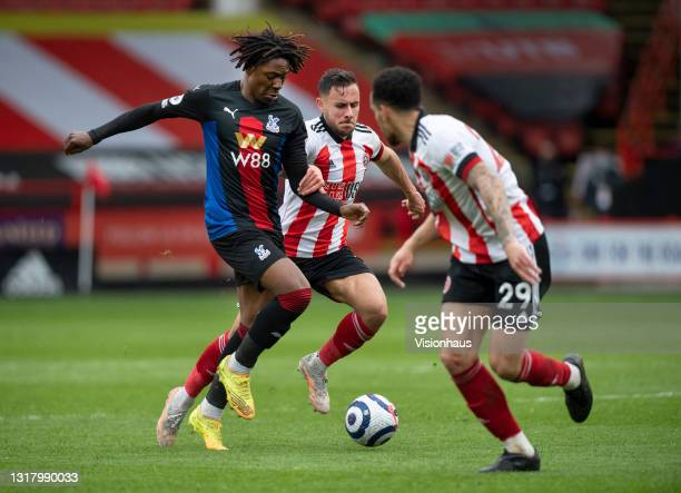 Eberechi Eze of Crystal Palace in action with George Baldock and Kean Bryan of Sheffield United during the Premier League match between Sheffield...