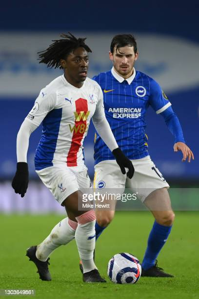 Eberechi Eze of Crystal Palace is challenged by Pascal Gross of Brighton & Hove Albion during the Premier League match between Brighton & Hove Albion...
