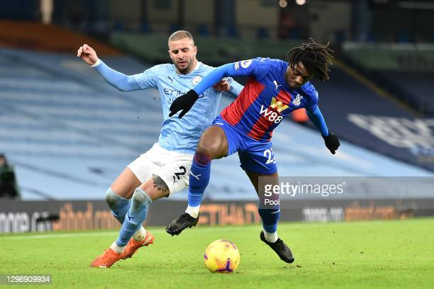 Eberechi Eze of Crystal Palace is tackled by Kyle Walker of Manchester City during the Premier League match between Manchester City and Crystal...