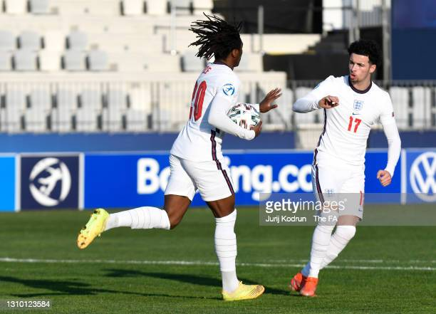 Eberechi Eze of England celebrates with Curtis Jones after scoring their team's first goal from the penalty spot during the 2021 UEFA European...