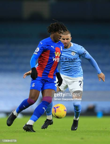 Eberechi Eze of Palace and Kyle Walker of Manchester City during the Premier League match between Manchester City and Crystal Palace at the Etihad...
