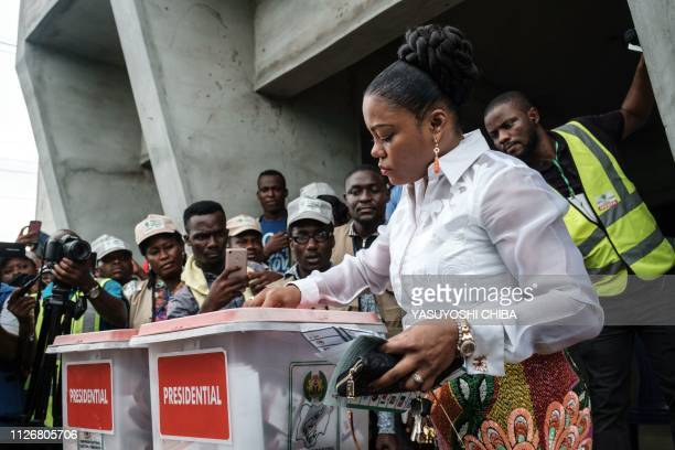 Eberechi Wike wife of Rivers state's Governor Ezenwo Nyesom Wike casts her ballot as voting in the presidential and parliamentary elections on...