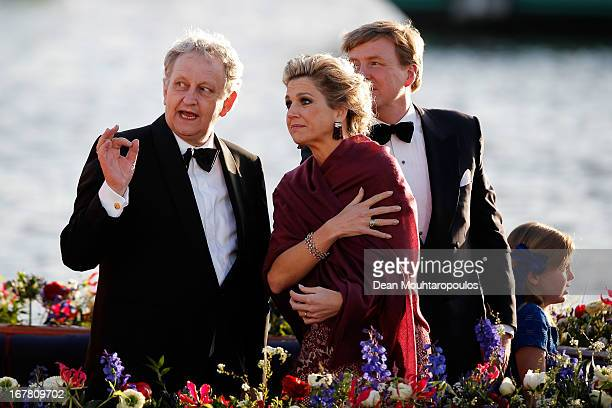 Eberhard E. Van der Laan , Mayor of Amsterdam speaks to King Willem Alexander and Queen Maxima of the Netherlands aboard the King's boat for the...