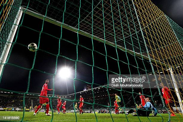 Ebi Smolarek of Den Haag shoots and scores the first goal of the game during the Eredivisie match between ADO Den Haag and FC Twente at Kyocera...