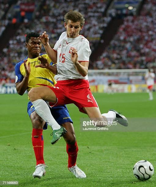 Ebi Smolarek of Poland keeps the ball away from Ulises De la Cruz of Ecuador during the FIFA World Cup Germany 2006 Group A match between Poland v...