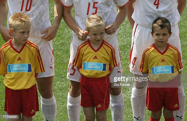 Ebi Smolarek of Poland pulls the ears of a mascot during the FIFA World Cup Germany 2006 match between Costa Rica and Poland played at the Stadium...
