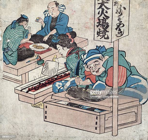 Ebisu and catfish Print shows Ebisu one of the seven lucky gods of Japan cutting up a catfish a woman fans a hibachi next to him and on the left two...