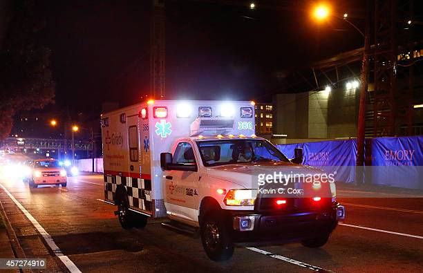Ebola patient Amber Vinson arrives by ambulance at Emory University Hospital on October 15 2014 in Atlanta Georgia Nurse Amber Vinson joins Nina Pham...