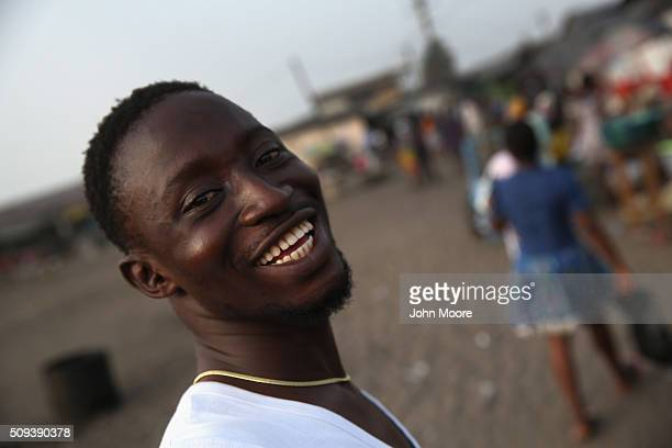 Ebola survivor Banganelee Yougi smiles while passing a market in the West Point slum on February 9 2016 in Monrovia Liberia West Point the most...
