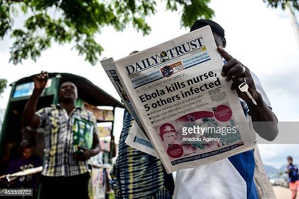 Ebola Virus news are the top stories on Nigeria's agenda on August 7 2014 A Nigerian man reads a newspaper of which the main page is covered with...