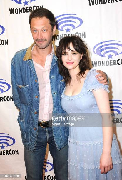 Ebon Moss-Bachrach and Ashleigh Cummings promote AMC's 'NOS4A2 ' on the Press Line at WonderCon 2019 - Day 2 held at Anaheim Convention Center on...