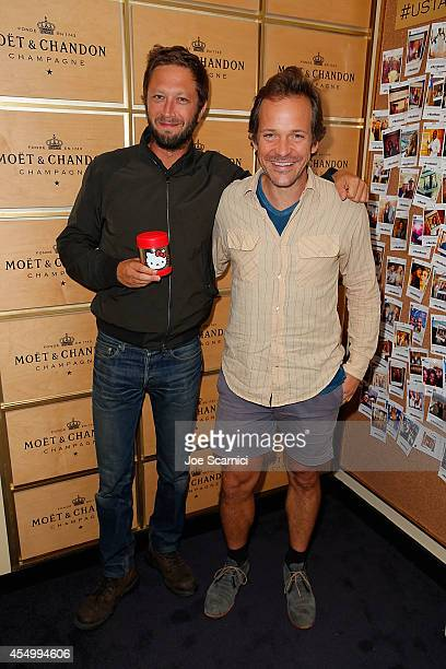 Ebon Moss-Bachrach and Peter Sarsgaard attend the Moet & Chandon Suite at the 2014 US Open Men's Final at USTA Billie Jean King National Tennis...