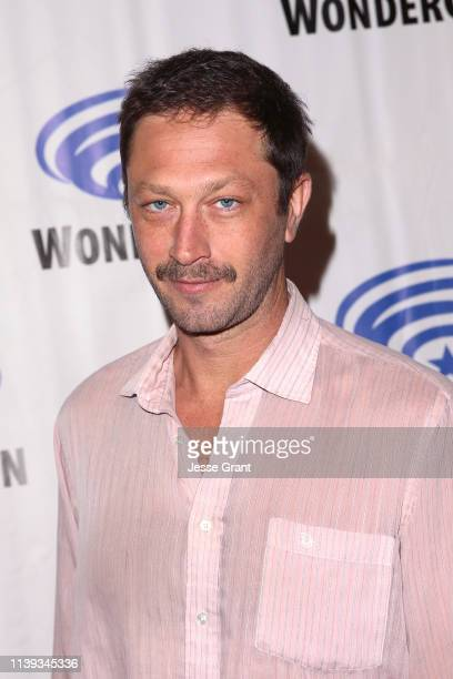 """Ebon Moss-Bachrach attends the Wondercon """"Nos4a2"""" screening and panel at Anaheim Convention Center on March 30, 2019 in Anaheim, California."""