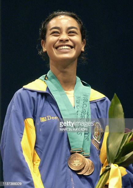 Ebonette Deigaeruk of Nauru with her 3 bronze medals after placing third in the 48Kg womens weightlifting at The Commonwealth Games in Manchester 30...