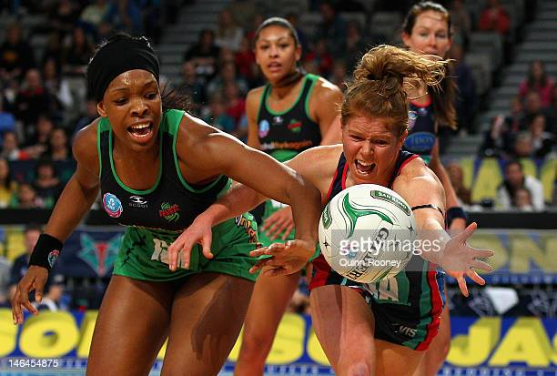 Eboni BeckfordChambers of the Fever and Tegan Caldwell of the Vixens contest for the ball during the round 12 ANZ Championship match between the...