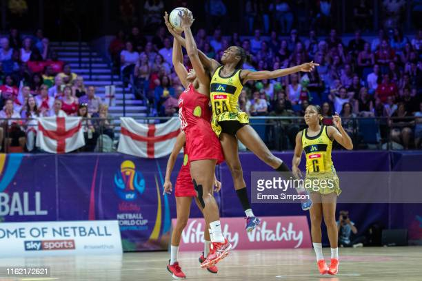 Eboni Usoro-Brown of England and Shanice Beckford of Jamaica jump for the ball during their Vitality Netball World Cup match at M&S Bank Arena on...