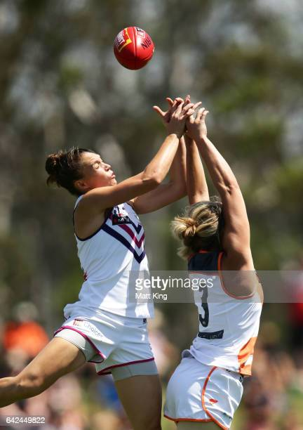 Ebony Antonio of the Dockers competes for the ball against Phoebe McWilliams of the Giants during the Women's round three match between Greater...