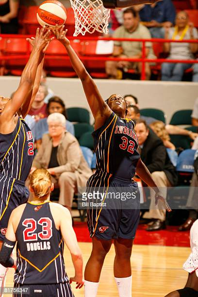Ebony Hoffman and Tamika Catchings of the Indiana Fever rebound the ball at Reliant Arena on June 28, 2008 in Houston, Texas. NOTE TO USER: User...