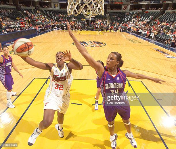 Ebony Hoffman of the Indiana Fever battles Adrian WilliamsStrong of the Sacramento Monarchs at Conseco Fieldhouse June 24 2008 in Indianapolis...