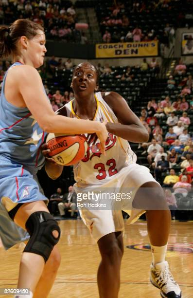 Ebony Hoffman of the Indiana Fever drives on Alison Bales of the Atlanta Dream at Conseco Fieldhouse on August 30 2008 in Indianapolis Indiana NOTE...