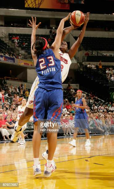 Ebony Hoffman of the Indiana Fever shoots over Plenette Pierson of the Detroit Shock in Game One of the Eastern Conference Semifinals during the 2008...