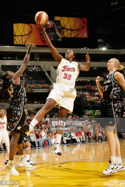 Ebony Hoffman of the Indiana Fever shoots over Sophia Young and Ann Water of the San Antonio Silver Stars at Conseco Fieldhouse on June 15 2008 in...