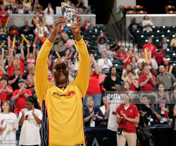 Ebony Hoffman of the Indiana Fever shows Fever fans the hardware she received after she was named the 2008 WNBA Most Improved Player prior to the...