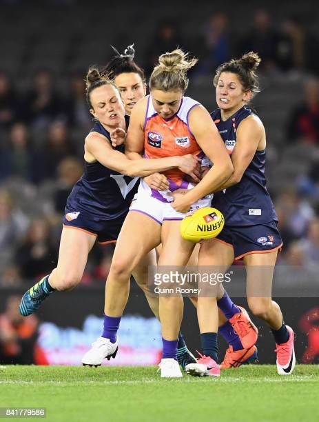 Ebony Marino of the Allies is tackled by Daisy Pearce and Jess Dal Pos of Victoria during the AFL Women's State of Origin match between Victoria and...
