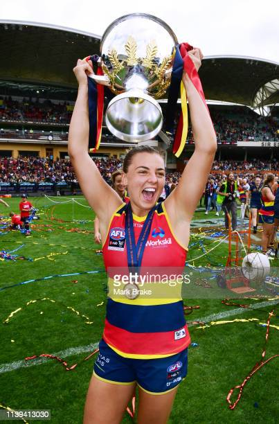 Ebony Marinoff of the Adelaide Crows hols up the Premiership Trophy during the AFLW Grand Final match between the Adelaide Crows and the Carlton...