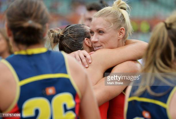Ebony Marinoff of the Adelaide Crows hugs Erin Phillips of the Adelaide Crows after winning the AFLW Preliminary Final match between the Adelaide...