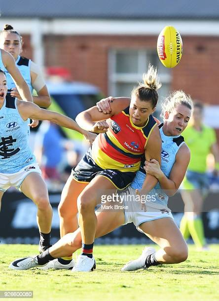 Ebony Marinoff of the Adelaide Crows tackled by Lauren Arnell of Carlton during the round five AFLW match between the Adelaide Crows and the Carlton...