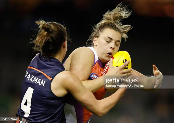 Ebony Marinoff of the Allies is tackled by Karen Paxman of Victoria during the AFL Women's State of Origin match between Victoria and the Allies at...