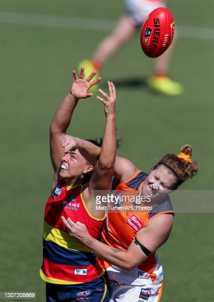 Ebony Marinoff of the Crows and Brittany Tully of the Giants compete for the ball during the 2020 AFLW Round 06 match between the Adelaide Crows and...