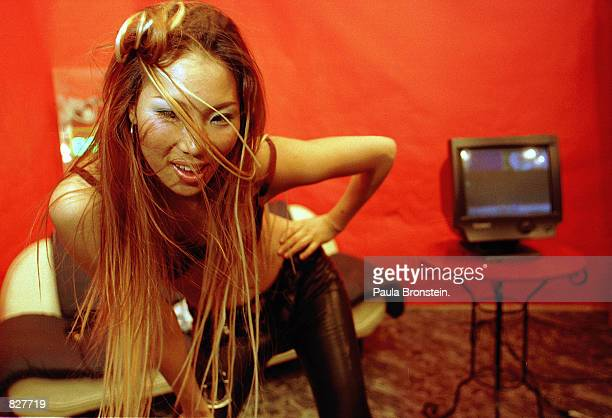 Ebony undresses in front of the digicam in the studio of Enterchannel in Seoul South Korea February 2000 She is featured live on the internet and...