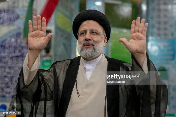Ebrahim Raisi, a candidate in Iran's presidential elections waves to the media after casting his vote at a polling station on June 18 on the day of...