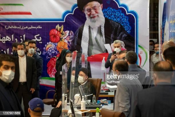 Ebrahim Raisi , conservative politician and head of Iran's judiciary, sits under a portrait of Irans Supreme Leader Ayatollah Ali Khamenei while...