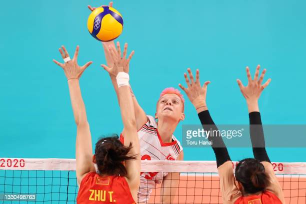 Ebrar Karakurt of Team Turkey attempts to hit over the Team China defense during the Women's Preliminary - Pool B on day two of the Tokyo 2020...