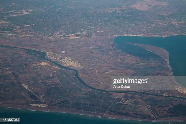 ebro delta view from above with river and town. - delta del ebro fotografías e imágenes de stock
