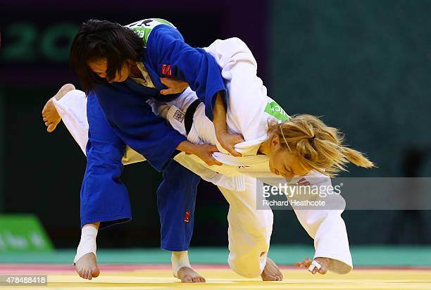 Ebru Sahin of Turkey and Charline van Snick of Belgium compete during the Women's Judo 48kg gold medal match on day thirteen of the Baku 2015...