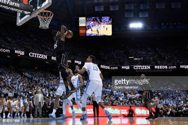 Ebuka Izundu of the Miami Hurricanes dubks against the North Carolina Tar Heels during their game at the Dean Smith Center on February 27 2018 in...