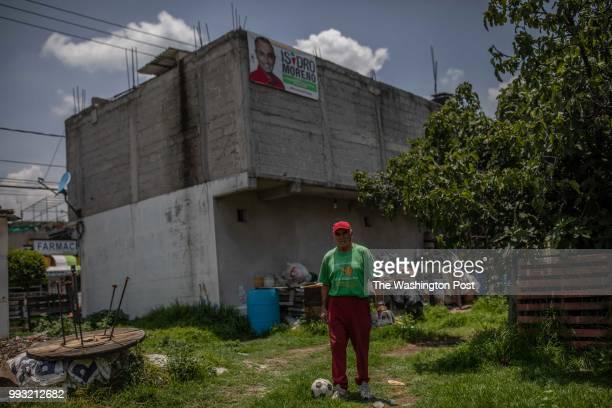 Victor Villanueva poses for a portrait in front of his house Victor has been always a supporter of Partido Revolucionario Institucional PRI which has...